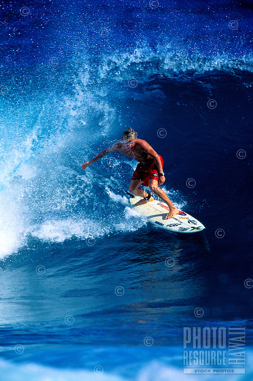 Surfer Jairus Cannon surfing on the north shore of Maui