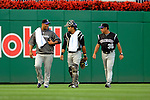 16 August 2008: Colorado Rockies' starting pitcher Livan Hernandez (left) walks back to the dugout after warming up with catcher Yorvit Torrealba (center) and pitching coach Bob Apodaca (right) prior to a game against the Washington Nationals at Nationals Park in Washington, DC.  Hernandez recorded his first win since coming to Colorado as the Rockies defeated the Nationals 13-6, handing the last place Nationals their 9th consecutive loss. ..Mandatory Photo Credit: Ed Wolfstein Photo
