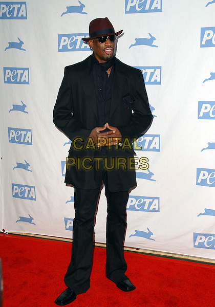 DENNIS RODMAN.Peta's 25th Anniversary Gala and Humanitarian Awards Show held at Paramount Pictures' Studios in Hollywood,California onn .September 10th, 2005.full length black suit hat sunglasses shades fingers linked crossed.www.capitalpictures.com.sales@capitalpictures.com.Supplied By Capital PIctures