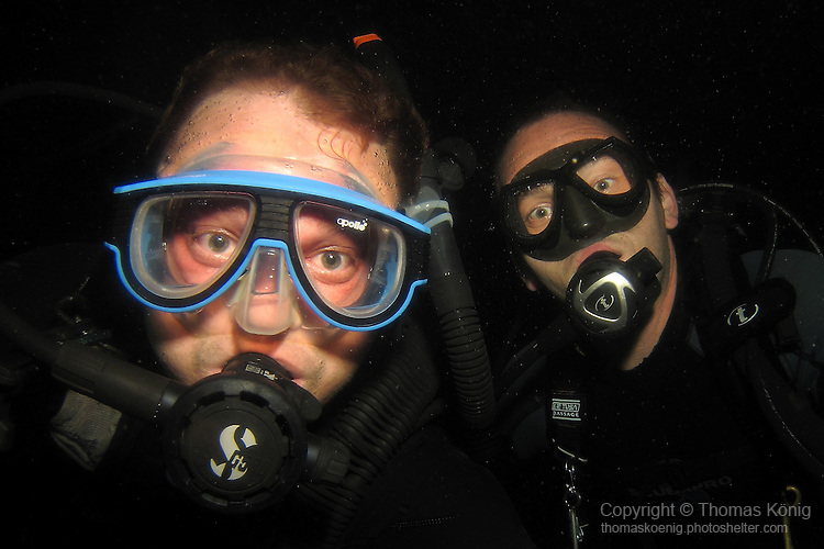 Kenting, Taiwan -- The photographer and his dive buddy on a night dive.