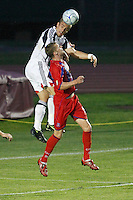 Crystal Palace defender Andrew Marshall (5) and New England Revolution forward Taylor Twellman (20) go up for a header. The New England Revolution (MLS) defeated Crystal Palace FC USA of Baltimore (USL2) 5-3 in penalty kicks after finishing regulation and overtime tied at 1-1 during a Lamar Hunt US Open Cup quarterfinal match at Veterans Stadium in New Britain, CT, on July 8, 2008.