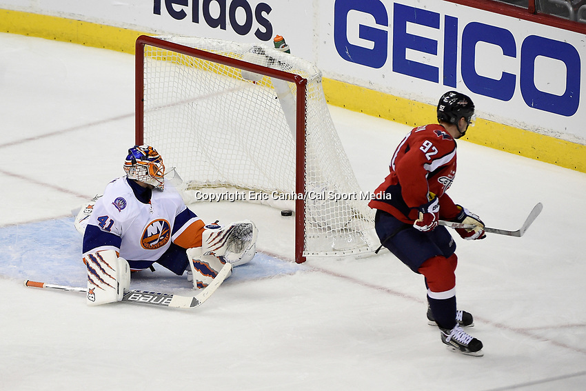 April 23, 2015 - Washington D.C., U.S. - Washington Capitals center Evgeny Kuznetsov (92) scores a goal against New York Islanders goalie Jaroslav Halak (41) during game 5 of the  NHL Eastern Conference Quarter finals between the New York Islanders and the Washington Capitals held at the Verizon Center in Washington DC. The Capitals defeat the Islanders 5-1 in regulation time to take the lead in the 7 game series 3-2. Eric Canha/CSM
