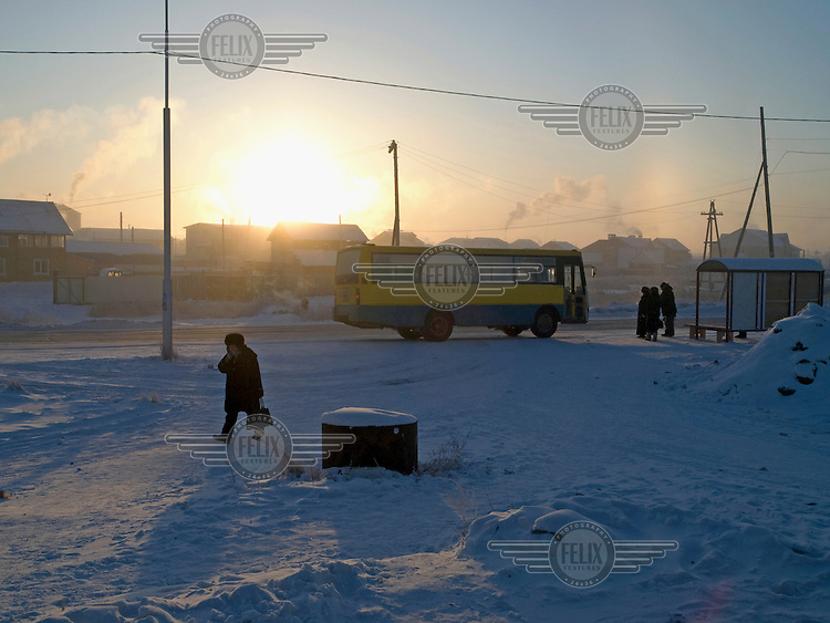Bus stop at sunrise on the outskirts of the city. Jakutsk is a city in the Russian Far East, located about four degrees (450 km) below the Arctic Circle. It is the capital of the Sakha (Jakutia) Republic (formerly the Jakut Autonomous Soviet Socialist Republic), and a major port on the Lena River. Jakutsk is one of the coldest cities on earth, with winter temperatures averaging -40.9 degrees Celsius.