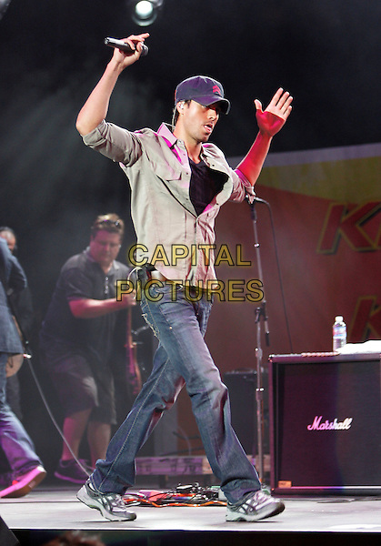 ENRIQUE IGLESIAS.Performs live on stage at The 10th Annual KIIS FM Wango Tango 2007 held at Verizon Wireless Ampitheatre in Irvine, California, USA, May 12th 2007..full length cap hat concert gig shirt  hands arms jeans trainers.CAP/DVS.©Debbie VanStory/Capital Pictures