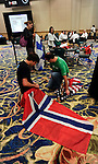 Assistants ready the flags for the start of the competion in the World Cup of Poker