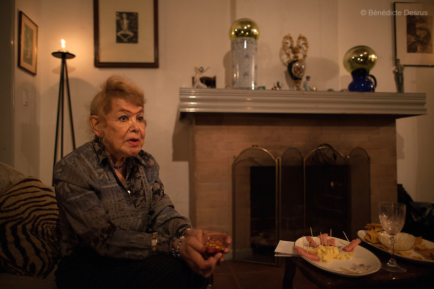 """September 17, 2012 - Mexico City, Mexico - Samantha, during a meeting to set up the non-profit organization """"Laetus Vitae"""", at the house of her friend Fabiola Díaz de León in Mexico City. Samantha Flores is an 80-year-old transgender woman from Veracruz, Mexico. She is a prominent social activist for LGBTQI rights and is the founder of the non-profit organization """"Laetus Vitae"""", a day shelter for elderly gay people in Mexico City. Senior citizens in general are many times prone to neglect and abandonment by their families, leaving them all but invisible. Their plight can be even worse if they are homosexual. Photo credit: Bénédicte Desrus"""