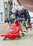 9 January 2016: Italian pilot Simone Bertazzo leads his 4-man team as they push off their first run of the day at the BMW IBSF World Cup Bobsled Championships at the Olympic Sports Track in Lake Placid, New York, USA. Bertazzo's team came in 11th for the day, with a 2-run combined time of 1:50.99. Mandatory Credit: Ed Wolfstein Photo *** RAW (NEF) Image File Available ***