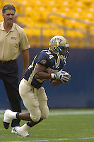 23 September 2006:  Pitt Coach Dave Wannstedt watches as LaRod Stephens-Howling (34) returns a kick during warm ups..The Pittsburgh Panthers defeated the Citadel Bulldogs 51-6 September 23, 2006 at Heinz Field in Pittsburgh, PA..
