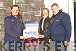 ALARM: At the RNLI Fenit on Tuesday, Padraig McElligott of Sure Alarms Tralee (left) presented Kevin Honeyman (mechanic) of the RNLI Fenit with a Sure Alarm system. Also in picture is Angelina Elbell (marketing manager Sure Alarms).