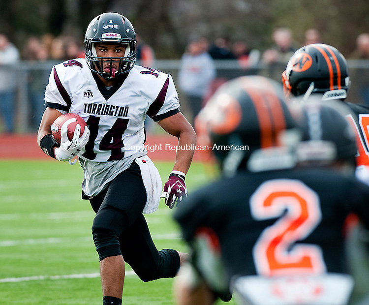 WATERTOWN, CT--- -112265JS14-Torrington's Newton Frias (14) looks for some running room during their Thanksgiving day game against Watertown Thursday at Watertown High School. <br /> Jim Shannon Republican-American