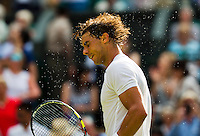 England, London, 24.06.2014. Tennis, Wimbledon, AELTC, Rafael Nadal (ESP) shakes the sweat of his head after his match against Klizan<br /> Photo: Tennisimages/Henk Koster