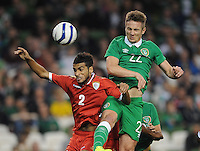 3rd September 2014; International Friendly, Republic of Ireland v Oman, Aviva Stadium, Dublin. <br /> Republic of Ireland's Kevin Doyle with Mohammed Al Musalami of Oman<br /> Picture credit: Tommy Grealy/actionshots.ie.