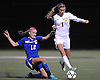 Massapequa No. 1 Julia Hannon, right, looks to maintain possession under pressure from West Islip No. 12 Alyssa Gillespie during the first half of the varsity girls' soccer Class AA Long Island Championship at Adelphi University on Saturday, November 7, 2015. Massapequa went to halftime leading 1-0.<br /> <br /> James Escher
