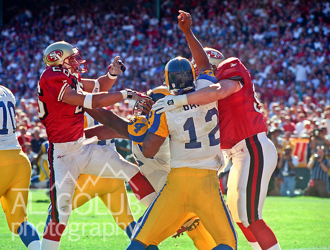 San Francisco 49ers vs. St. Louis Rams at Candlestick Park Sunday, October 12, 1997.  49ers beat Rams  30-10.  San Francisco 49ers linebacker Rod Woodson (26) and linebacker Kevin Greene (91) rush St. Louis Rams quarterback Tony Banks (12).