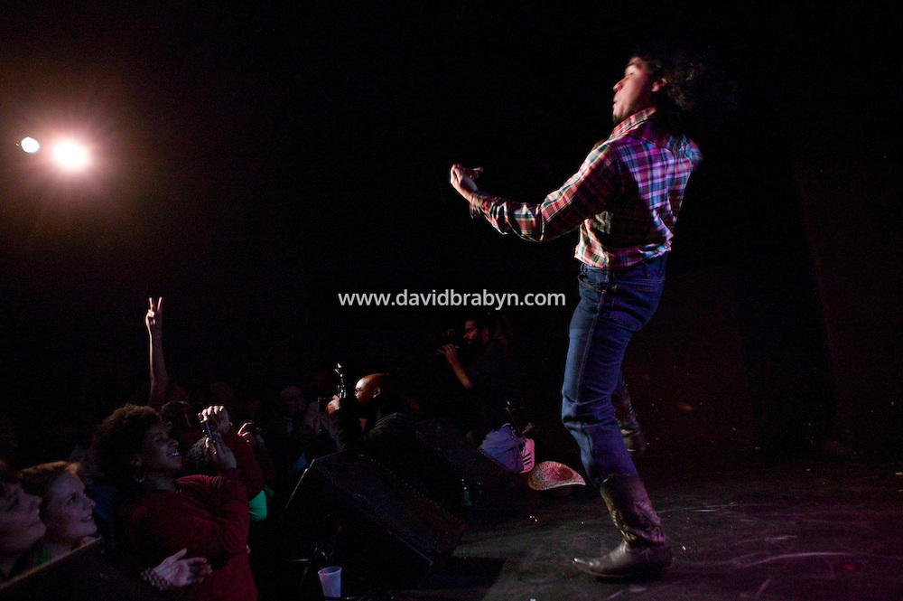2 March 2006 - New York City, NY - A competitor performs on stage in an air guitar competition in New York City, USA, 2 March 2006. Air guitar is the act of pretending to play guitar with exaggerated strumming motion and loud singing or lip-synching. The first Annual Air Guitar World Championship took place in 1996 in Finland.