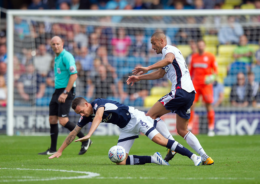 Bolton Wanderers' Darren Pratley battles for possession with Millwall's Shaun Williams<br /> <br /> Photographer Ashley Western/CameraSport<br /> <br /> The EFL Sky Bet Championship - Millwall v Bolton Wanderers - Saturday August 12th 2017 - The Den - London<br /> <br /> World Copyright &not;&copy; 2017 CameraSport. All rights reserved. 43 Linden Ave. Countesthorpe. Leicester. England. LE8 5PG - Tel: +44 (0) 116 277 4147 - admin@camerasport.com - www.camerasport.com