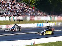 Jun. 1, 2014; Englishtown, NJ, USA; NHRA top fuel driver Richie Crampton (right) races alongside Dom Lagana during the Summernationals at Raceway Park. Mandatory Credit: Mark J. Rebilas-