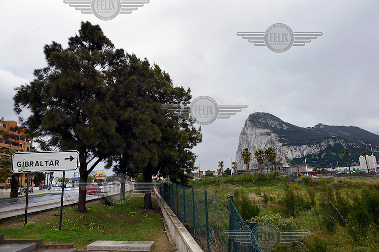 A sign points to Gibraltar at the British Overseas Territory's border with Spain.