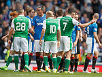 Bruno Alves has words with Anthony Stokes as the referee thinks about his decision in the background