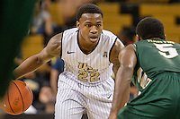 December 17, 2013 - Orlando, FL, U.S: Central Florida guard Brandon Goodwin (22) is defended by JU guard Vince Martin (5) during 2nd half mens NCAA basketball game action between the Jacksonville Dolphins and the UCF Knights. UCF defeated Jacksonville 104-64 at the CFE Arena in Orlando, Fl.
