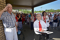 NWA Democrat-Gazette/BEN GOFF &bull; @NWABENGOFF<br /> Cal Floren (from left), Joe Ranieri and Shirley Sautter join in the Pledge of Allegiance on Sunday July 5, 2015 during the 4th of July program at United Lutheran Church in Bella Vista. The congregation gathered by the flagpole to pray, sing patriotic songs and recite the Pledge of Allegiance before service.
