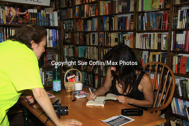 """Angela Farino has a book signed - Another World's Alicia Coppola speaks and signs her book """"Gracefully Gone"""" - a fusion of two journals: her father Matthew L. Coppola Sr. and hers - on August 23, 2013 at Book Revue, Huntington, New York. (Photo by Sue Coflin/Max Photos)"""