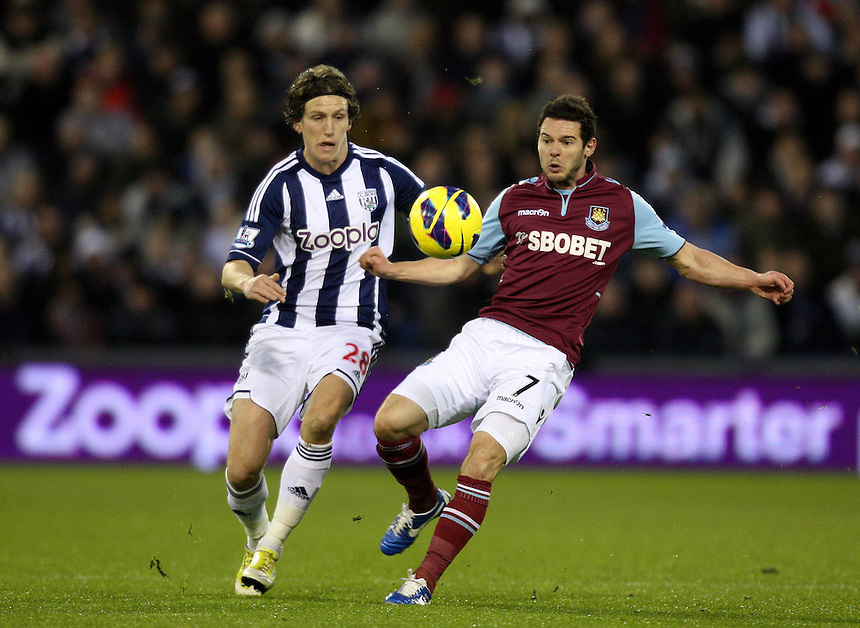 West Bromwich Albion's Billy Jones battles with West Ham United's Matthew Jarvis ..Football - Barclays Premiership - West Bromwich Albion v West Ham United - Sunday 16th December 2012 - The Hawthorns - West Bromwich ..
