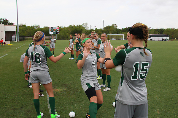 Denton, TX - AUGUST 31: Carly McDowell #4 of the North Texas Mean Green soccer team introduction against University of Houston Cougars at the Mean Green Village Soccer Field on August 31, 2012 in Denton, Texas. NT won 2-1.(Photo by Rick Yeatts)