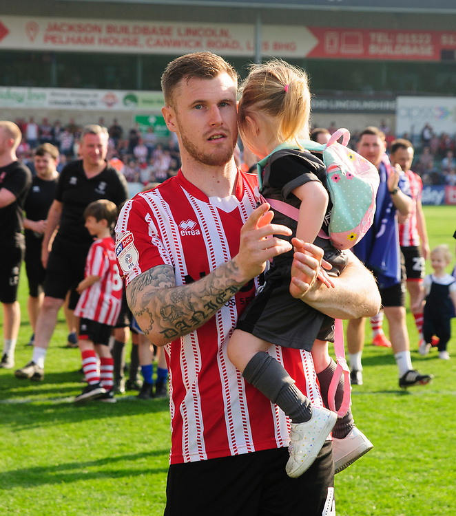Lincoln City's Michael O'Connor applauds the fans at the final whistle<br /> <br /> Photographer Andrew Vaughan/CameraSport<br /> <br /> The EFL Sky Bet League Two - Lincoln City v Tranmere Rovers - Monday 22nd April 2019 - Sincil Bank - Lincoln<br /> <br /> World Copyright © 2019 CameraSport. All rights reserved. 43 Linden Ave. Countesthorpe. Leicester. England. LE8 5PG - Tel: +44 (0) 116 277 4147 - admin@camerasport.com - www.camerasport.com