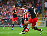 Lincoln City's Bruno Andrade vies for possession with Swindon Town's Oliver Lancashire<br /> <br /> Photographer Andrew Vaughan/CameraSport<br /> <br /> The EFL Sky Bet League Two - Lincoln City v Swindon Town - Saturday August 11th 2018 - Sincil Bank - Lincoln<br /> <br /> World Copyright &copy; 2018 CameraSport. All rights reserved. 43 Linden Ave. Countesthorpe. Leicester. England. LE8 5PG - Tel: +44 (0) 116 277 4147 - admin@camerasport.com - www.camerasport.com