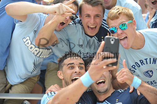 Jul 6, 2014; Kansas City, KS, USA; Sporting KC forward Dom Dwyer (14) celebrates by taking a selfie with fans after scoring a goal against the Chicago Fire during the first half of the match at Sporting Park. Mandatory Credit: Denny Medley-USA TODAY Sports