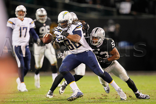 24.12.2015. Oakland, CA, USA - The San Diego Chargers' David Johnson fumbles against the Oakland Raiders in the fourth quarter at Oakland Colliseum in Oakland, Calif., on Thursday, Dec. 24, 2015