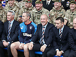 Rangers manager Mark Warburton and directors with members of HM armed forces at Ibrox today