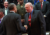 United States President Barack Obama shakes hands with John Negroponte, former Director of National Intelligence,  during a ceremony marking the 10th anniversary of the formation for the Office of the Director of National Intelligence, at it's headquarters on April 24, 2015 in McLean, Virginia. <br /> Credit: Kevin Dietsch / Pool via CNP