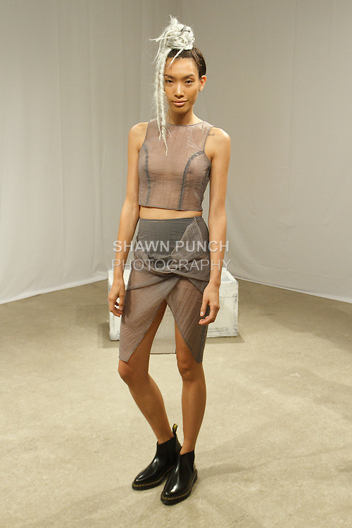 """Model poses in an outfit from the Rinat Brodach Spring Summer 2017 """"About Last Night"""" collection by Rinat Brodach at The AFA Gallery on 54 Greene Street, New York City, on September 12, 2016 during New York Fashion Week Spring Summer 2017."""