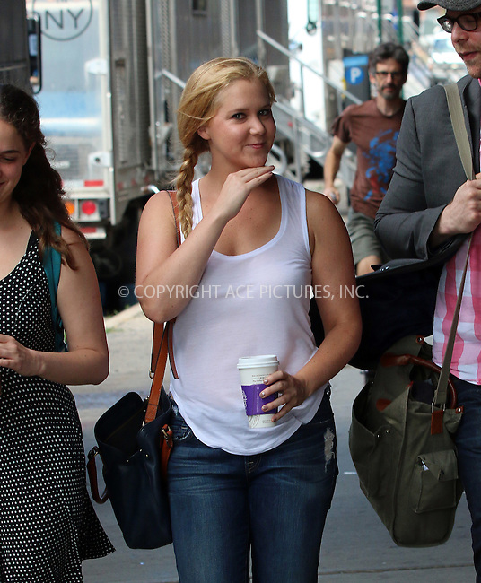 ACEPIXS.COM<br /> <br /> July 28 2014, New York City<br /> <br /> Actress Amy Schumer was on the set of the new movie 'Trainwreck' on July 28 2014 in New York City<br /> <br /> <br /> By Line: Zelig Shaul/ACE Pictures<br /> <br /> ACE Pictures, Inc.<br /> www.acepixs.com<br /> Email: info@acepixs.com<br /> Tel: 646 769 0430