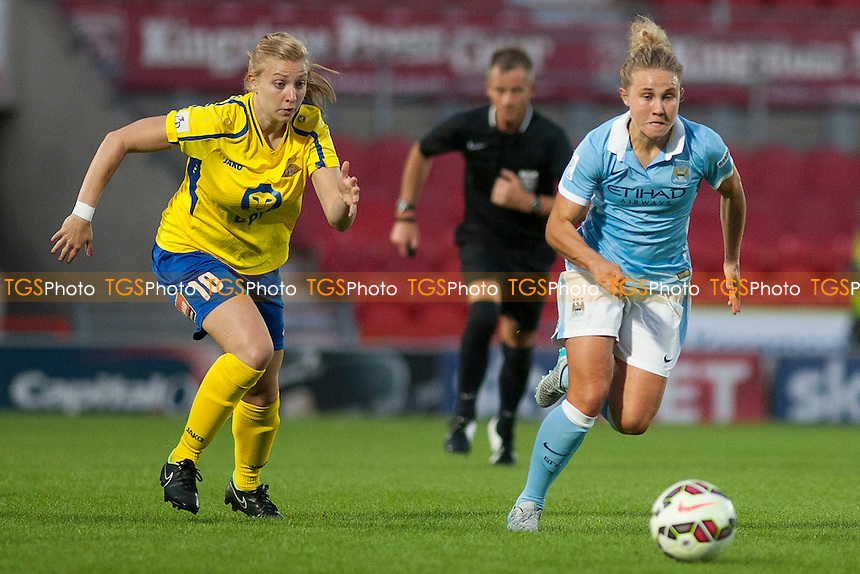 Emily Roberts (Belles) and Isobel Christiansen (Man City Women)<br /> Doncaster Rovers Belles vs Manchester City Women, FA Womens Super League Continental Tyres Cup Football at the Keepmoat Stadium, Stadium Way, Doncaster, West Riding of Yorkshire on 23/07/2015 - MANDATORY CREDIT: Mark Hodsman/TGSPHOTO