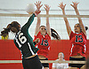 Sophie Dandola #16 of Seaford, left, looks to get a spike past Mineola's Katie Assalone #19, center, and Vickie Venus during a Nassau County varsity girls volleyball match at Mineola High School on Thursday, Sept. 22, 2016. Dandola recorded 18 kills and nine aces in Seaford's 3-1 win.