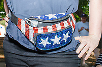 A person wears an American-flag themed fanny pack at the Iowa State Fair in Des Moines, Iowa, on Tues., Aug. 13, 2019.