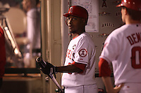 ANAHEIM - OCTOBER 9:  Chone Figgins of the Los Angeles Angels of Anaheim stands in the dugout against the Boston Red Sox during Game 2 of the American League Division Series at Angel Stadium on October 9, 2009 in Anaheim, California. Photo by Brad Mangin
