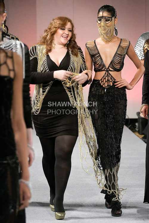 Fashion designer Laure Mae DeWitt, walks runway with Hoàng Thùy, Vietnam's Next Top Model Winner 2011, at the close of her Laure Luxe Fall 2012 collection fashion show, during Couture Fashion Week in New York, February 18, 2012.