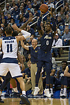 Akron guard Jimond Ivey (0)shoots a three pointer         against Nevada in the second half of an NCAA college basketball game in Reno, Nev., Saturday, Dec. 22, 2018. (AP Photo/Tom R. Smedes)