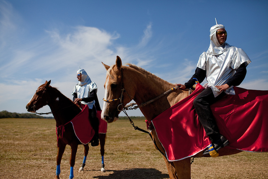Skilled horsemen dressed as knights from the cajun prairie compete in Le Tournoi near Ville Platte, Louisiana each October during the Louisiana Cotton Festival. The horsemen joust seven rings along a quarter-mile semi-circular track. The seven rings symbolize the seven enemies of cotton which are flood, drought, boll weevil, bollworm, silk, rayon and nylon.  The knight run three heats each to decide the new champion. Le Tournoi has its roots in the medieval french tradition of jousting, and was revived in Ville Platte in 1948. October 17, 2010.