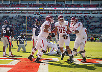 Hawgs Illustrated/BEN GOFF <br /> Colton Jackson (from left), Arkansas tackle, Cheyenne O'Grady (85), Arkansas tight end, and Johnny Gibson, Arkansas tackle, celebrate after O'Grady scored a touchdown in the third quarter against Ole Miss Saturday, Oct. 28, 2017, at Vaught-Hemingway Stadium in Oxford, Miss.