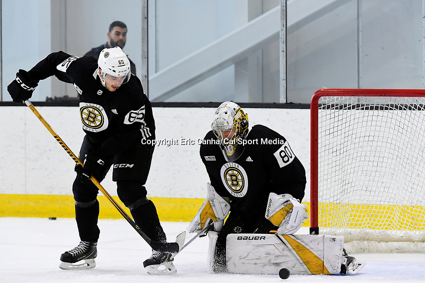 June 28, 2018: Boston Bruins forward Cedric Pare (65) goes to his backhand on goalie Dan Vladar (80) during the Boston Bruins development camp held at Warrior Ice Arena in Brighton Mass. Eric Canha/CSM