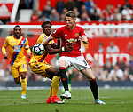Wilfried Zaha of Crystal Palace in action with Scott McTominay of Manchester United during the English Premier League match at the Old Trafford Stadium, Manchester. Picture date: May 21st 2017. Pic credit should read: Simon Bellis/Sportimage