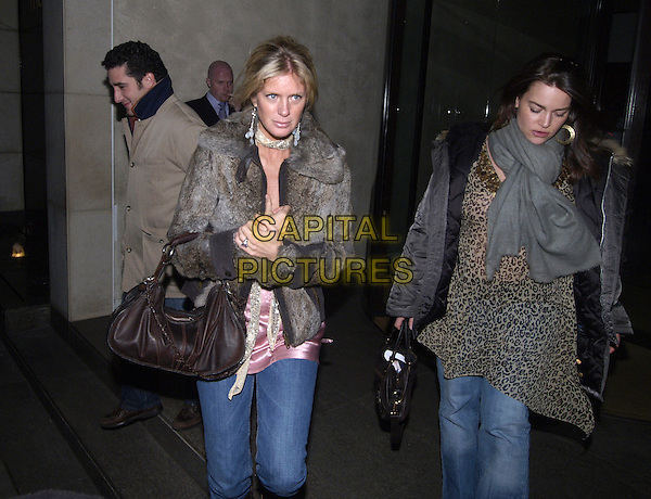 RACHEL HUNTER.Leaving Metropol Hotel After dinner at Nobu.February 12th, 2005.half length, fur jacket coat brown leather bag purse ring.www.capitalpictures.com.sales@capitalpictures.com.©Capital Pictures.