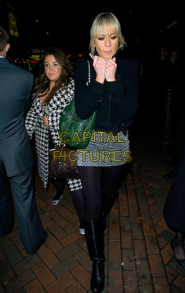"KATE LAWLER.Leaving the ""Rocky Balboa"" Uk Premiere,.Vue West End, London, England,.January 16th 2006..full length green bag hands blackjacket tights mini skirt.CAP/CAN.©Can Nguyen/Capital Pictures"