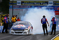 Jun 3, 2016; Epping , NH, USA; NHRA pro stock driver Allen Johnson does a burnout during qualifying for the New England Nationals at New England Dragway. Mandatory Credit: Mark J. Rebilas-USA TODAY Sports
