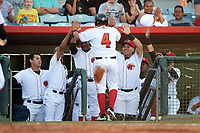 Florida Fire Frogs catcher Jonathan Morales (4) high fives teammates Ronald Acuna (left) and Wigberto Nevarez (right) after scoring the first run in the bottom of the second inning during the teams Inaugural  game against the Daytona Tortugas on April 6, 2017 at Osceola County Stadium in Kissimmee, Florida.  Daytona defeated Florida 3-1.  (Mike Janes/Four Seam Images)